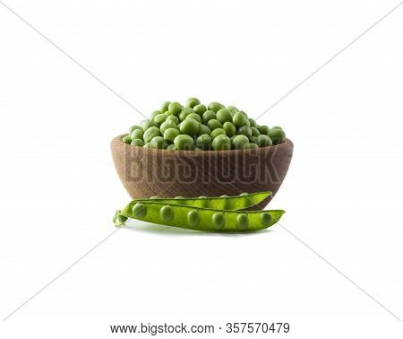 Green Peas On A Wooden Bowl Isolated On A White Background. Vegetables With Copy Space For Text. Gre