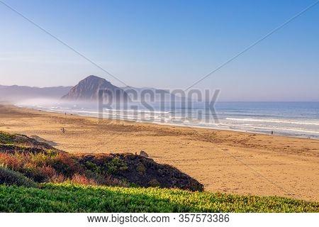 Beautiful  Panoramic View Of Morro Bay And Morro Rock In The Rays Of The Rising Sun. California. Usa
