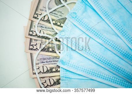 Protective Face Masks With Dollar Bills. Speculation And Rising Medicine Prices. Business For People