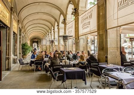 Barcelona, Spain - Feb 9, 2014: Tourists Sit At Tables On The Terrace Of The Rossini Restaurant Loca