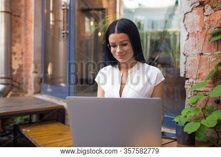 Pretty Woman In Glasses Skilled Freelance Copywriter Having Online Video Conference Via Portable Lap