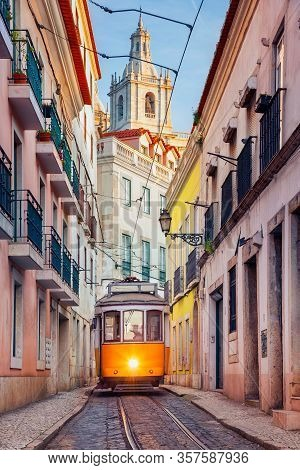 Lisbon, Portugal. Cityscape Image Of Street Of Lisbon, Portugal With Yellow Tram.