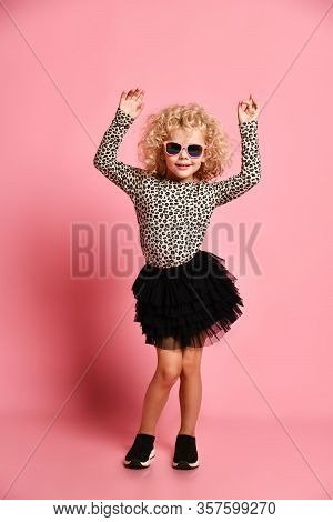 Frolic Kid Girl With Curly Blonde Hair In Sunglasses, Modern Fashion Black Skirt, Leopard Print Swea