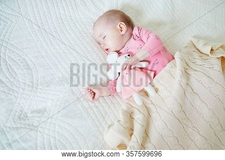 Baby Girl Having A Nap With Her Favorite Mouse Toy. Little Child Sleeping On Bed With Comforter. Sle