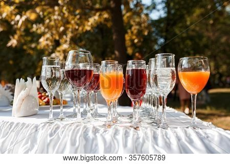 Glasses With Juice And Water On The Buffet Table