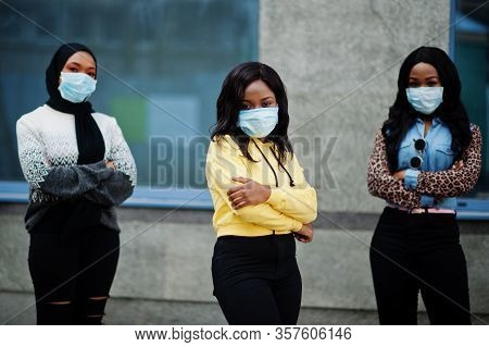Group Of Three African American Young Volunteers Wearing Face Mask Outdoors. Coronavirus Quarantine