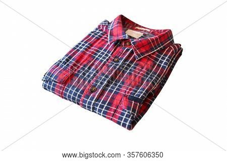 Kaliningrad, Russia - 03.20.2020: Red Checkered Flannel Shirt Folded On A White Isolated Background