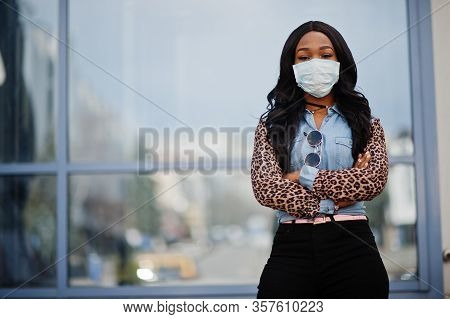 African American Young Volunteer Woman Wearing Face Mask Outdoors. Coronavirus Quarantine And Global