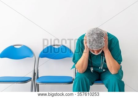 Woman Doctor Is Sitting And Has, Worry, Frustration, Tiredness And Exhausting Deep Feelings