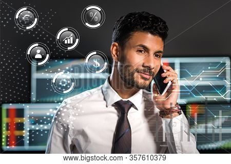 Happy Bi-racial Trader Talking On Smartphone Near Bubbles With Charts And Graphs