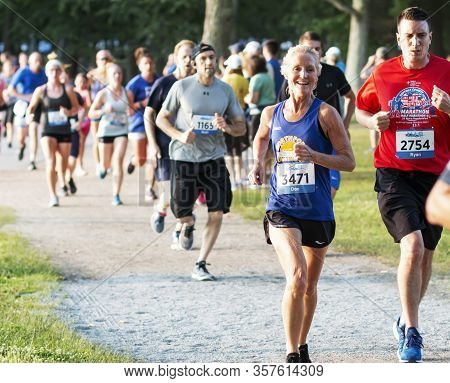 North Babylon, New York, Usa - 8 July 2019: Runners Racing On A Trail Around Belmont Lake During The