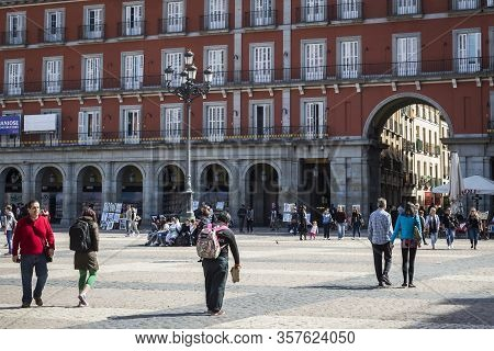 Madrid, Spain - 28 March, 2018: Madrid Plaza Mayor Is A City Attraction Visited By Tourists And Visi