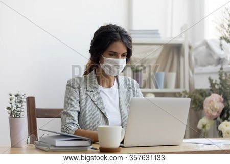 Female Employee In Medical Mask Working In Office