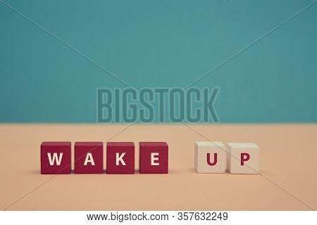 Waking Up. Awakening. Good Morning. Beginning New Day. Wake Up Inscription On Colorful Wooden Cubes.