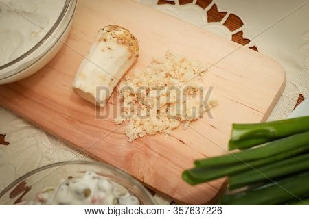 Traditional Easter Breakfast, Grated Horseradish On The Wooden Plank.