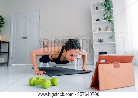 The Girl Goes In For Sports At Home. Online Fitness Workout.
