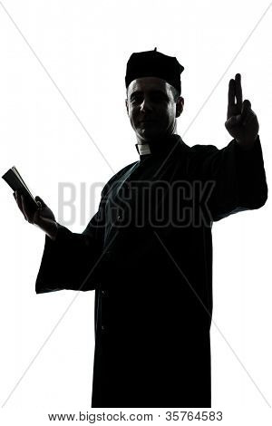 one caucasian man priest silhouette in studio isolated on white background