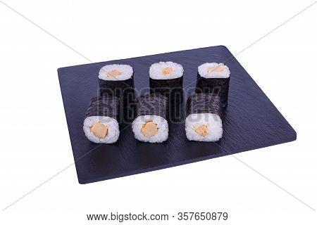 Traditional Fresh Japanese Sushi Maki On Black Stone Maki Tamago On A White Background. Roll Ingredi