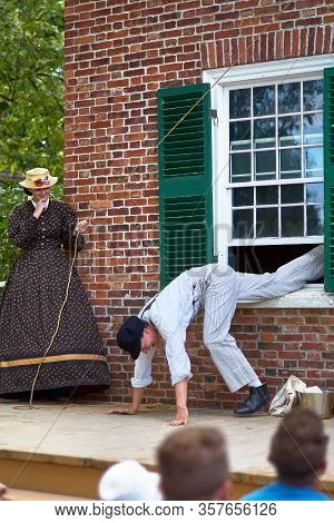 Upper Canada Village, Morrisburg, Ontario, Canada - October 17, 2019: Actors Play The Role Of Reside
