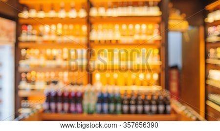 Background Blurred Defocused Beers Are Cooling In Fridge, Freezer Or Refrigerator Shelf. Defocused B