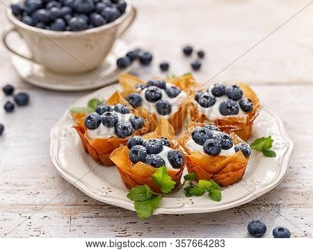 Phyllo Cups With Mascarpone Cheese Filling Topped With Fresh Blueberries Sprinkled With Powder Sugar