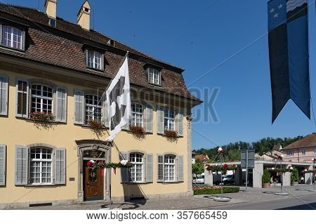 White Flag With The Black Tower Hanging On The Government On Sunny Day Of Brugg On Holiday On The 4t