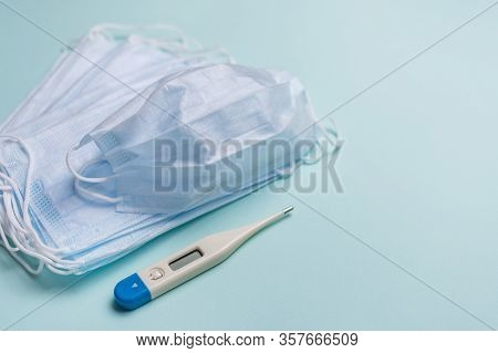Medical Mask For Protection On Blue Background. Against Coronavirus And Flue. Surgical Protective Ma
