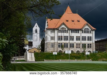 Schoolhouse With Church In Brugg. Stormy Weather, Church, Built Structure, Brugg, Stapferschulhaus