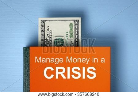 Managing Money in a Crisis. Book about financial literacy. Finance Savings Concept