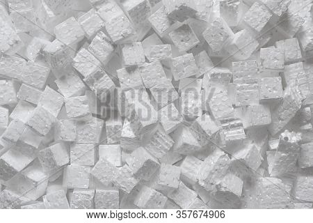 Many Small Cubes Of White Polystyrene, Top View. Packaging Material That Creates Protection For The