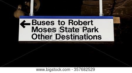 Sign Hanging At Babylon Railroad Station Directing People To The Bus To Robert Moses State Park Beac