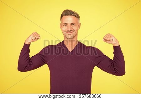 Confidence Is Best Outfit. Confident Man Yellow Background. Handsome Guy Flex Arms. Confident Look O