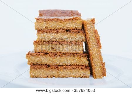 Stack Of Delicious Freshly Baked Blondie Brownie Dessert Slices, Close Up.