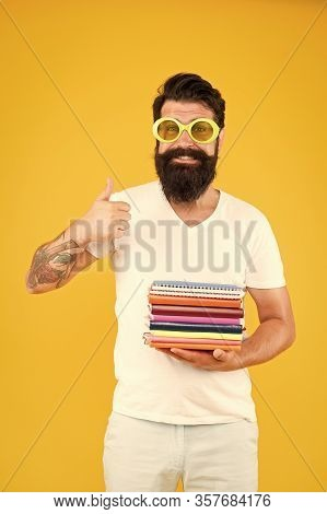 Colorful Stationery. Stationery Admirer. Buy Sketchbooks. Hipster Eccentric Guy Hold Pile Notepads.