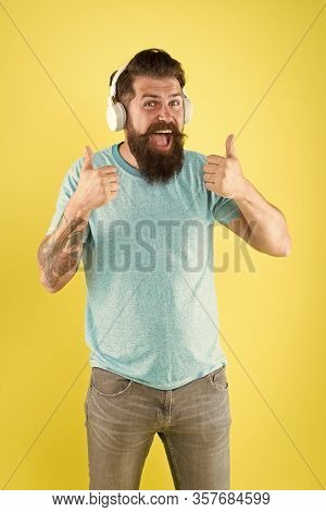 Bearded Man Listening Music Wireless Gadget. Freedom Going Wireless Offers You Is Unparalleled. Hips