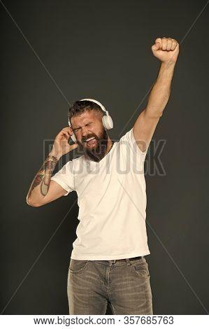 Always Winner. Happy Winner Celebrate With Music. Bearded Man In Headphones Make Winner Gesture. Emo