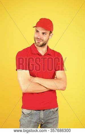Postman Delivery Worker. Man Red Cap Yellow Background. Delivering Purchase. Always On Time. Dedicat