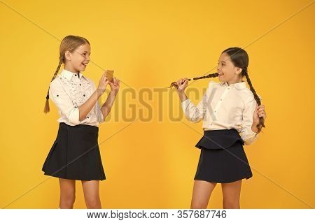 Blogger School. Schoolgirls Bloggers Use Smartphone Take Photo. Application Smartphone. Personal Blo