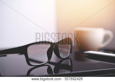 Office Workplace, Eyeglasses And Tablet On Designer Office Table, Close-up Of Eyeglasses On Table