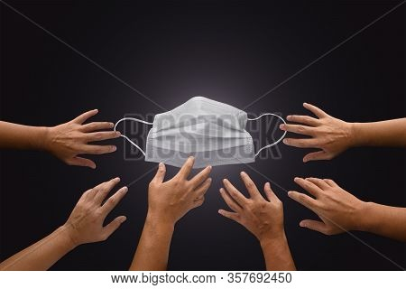 Mask With Many Hands Try To Grab Or Capture, Shortage Or Surging High Demand Of Respiratory Mask To