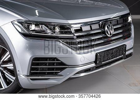 Volkswagen Touareg - Close-up Of The Headlight, Bumper, Wheel, Logo Radiator Grille, Hood. Novosibir