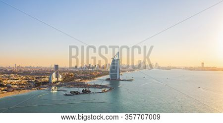 Aerial View Of Burj Al Arab Jumeirah Island Or Boat Building, Dubai Downtown Skyline, United Arab Em