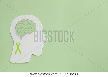 Brain Paper Cutout On Green Background,  Mental Health Concept, World Mental Health Day