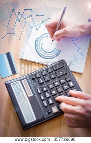 Banker Using Calculator With Financial Analysis Graphs. Cropped View Of Banker Counting On Calculato