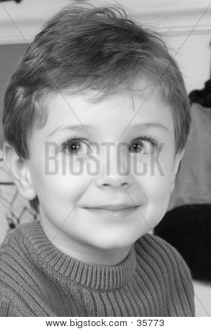 Adorable Four Year Old Boy With Big Blue Eyes