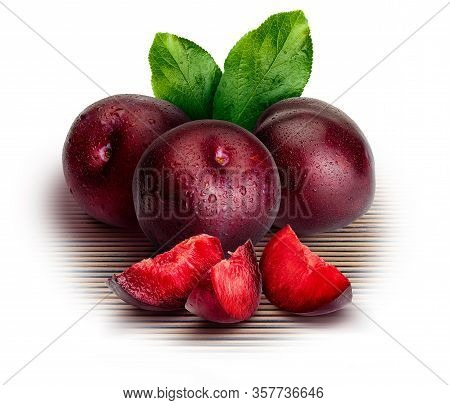 Appetizing And Healthy Red Plums, Whole And Cut Into Segments With An Aspect Of Illustration. Includ