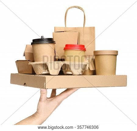 Hand Holding Various Take-out Food Containers, Pizza Box, Coffee Cups In Holder And Paper Bag Isolat