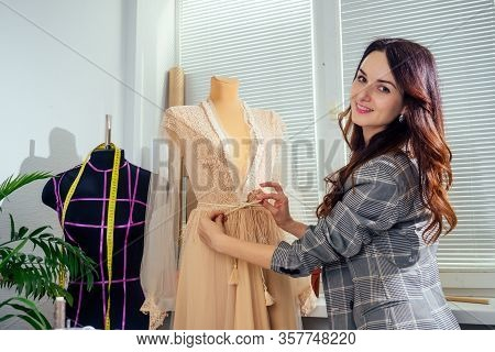 Caucasian Tailor Woman Sewing Lingerie In Showroom , She Sewing Outfit For Wedding Night