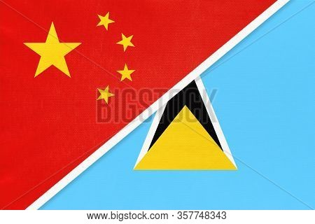 China Or Prc Vs Saint Lucia National Flag From Textile. Relationship Between Asian And American Coun