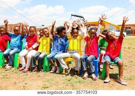 African Children Attending An Outside Preschool Classroom